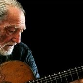 Willie Nelson playing guitar