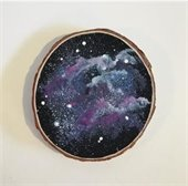 Galaxy painted on a slice of wood