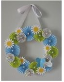 Photo of blue, white, yellow paper flower wreath