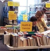 4 people shopping the book sale