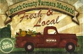 farmers market logo with old red truck filled with produce