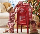 Little boy mailing letter to Santa