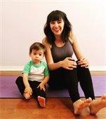 Kid and mom on yoga mat