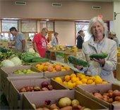 Food bank, woman with veggies