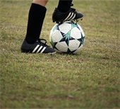 Soccer ball with foot