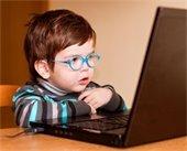 Young boy looking at computer screen