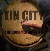 "Barrelhead with ""Tin City The Documentary Film"" printed on top"