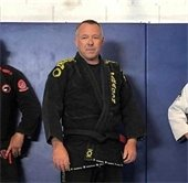 Chief Lewis posing in his gee with black belt