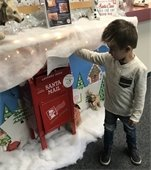 Kid mailing letter to Santa at Centennial
