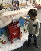 Kid mailing letter to Santa at Centennial