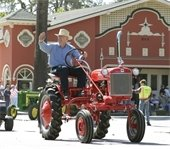 Tractor in front of bath house building