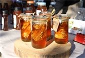 jars of honey with honeycomb inside