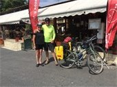 couple next to bike in outdoor marketplace