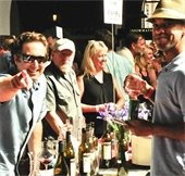 winemaker and winedrinker smiling at camera