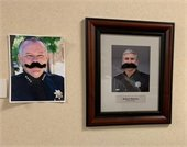 portraits of chief lewis and chief burton with giant mustaches affixed