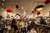 People shopping inside General Store  decorated for the holidays