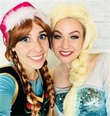 Girls dressed as Elsa and Anna from Frozen
