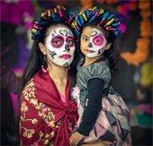 Mother and child in Dia de Los Muertos costumes