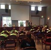 Kermit King Leadership class facing Mayor and Student Council on dais