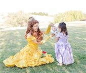 Belle pouring a girl tea