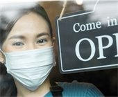 Woman in mask with open sign