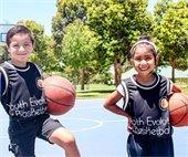 Boy and girl with basketballs