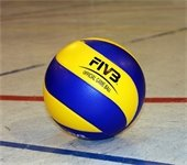 Blue and yellow volleyball on gym floor