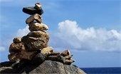 Rock cairn overlooking ocean