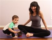 Mom and kid on yoga mat