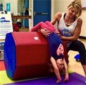 Britt with girl doing a backbend