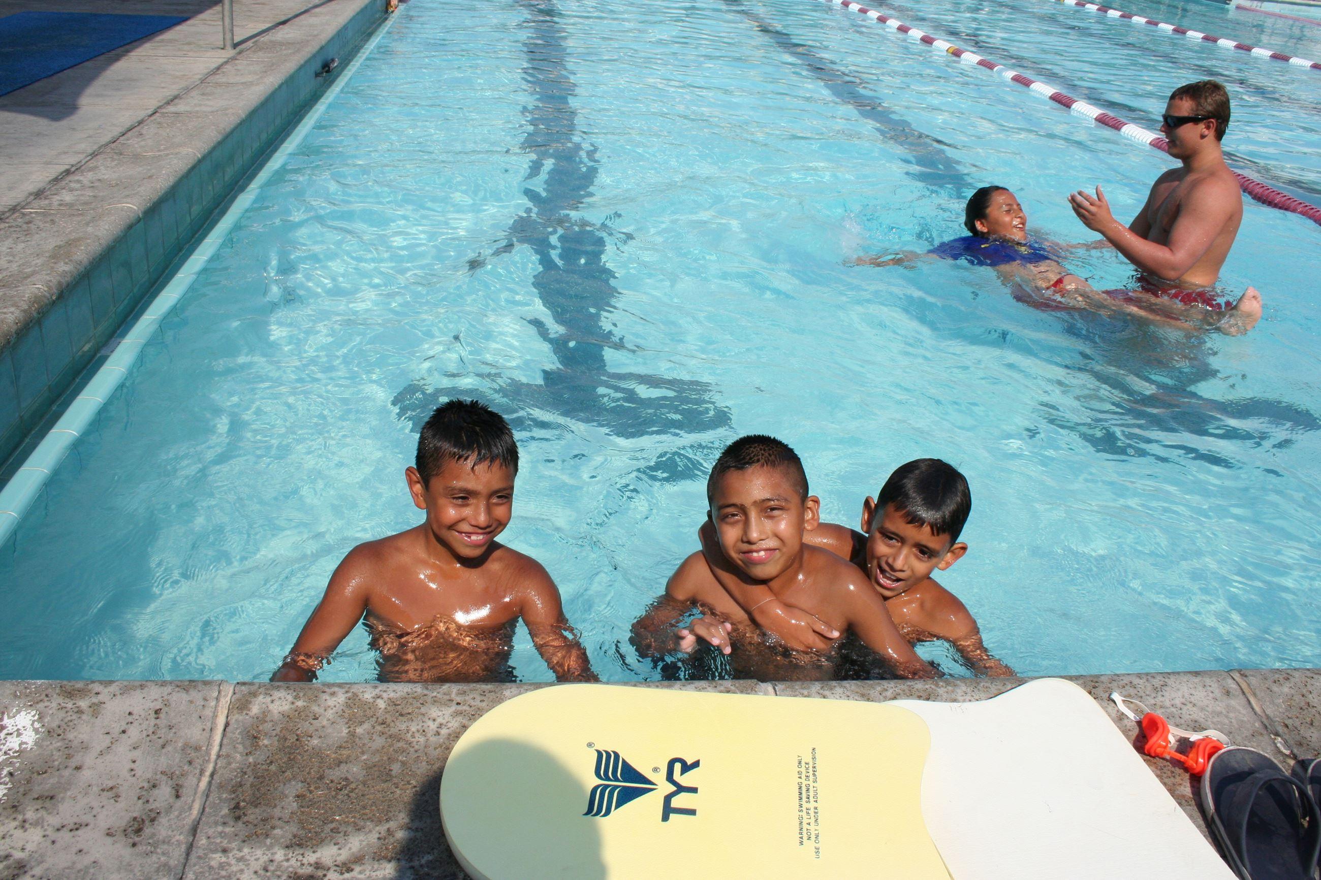 Boys swimming at Municipal Pool
