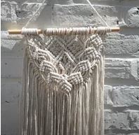Ropes knotted into decorative wall hangng