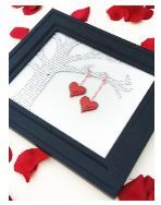 Photo of framed paper tree with valentine hanging from branch